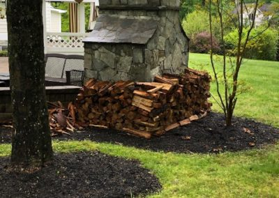 stacked_wood_around_outdoor_fireplace_fullsize_uncropped